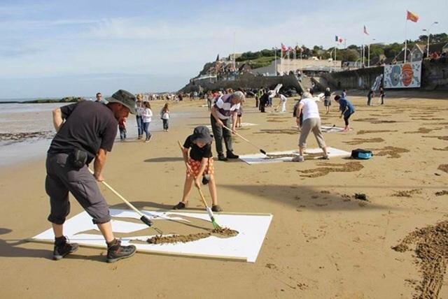People raking sand images