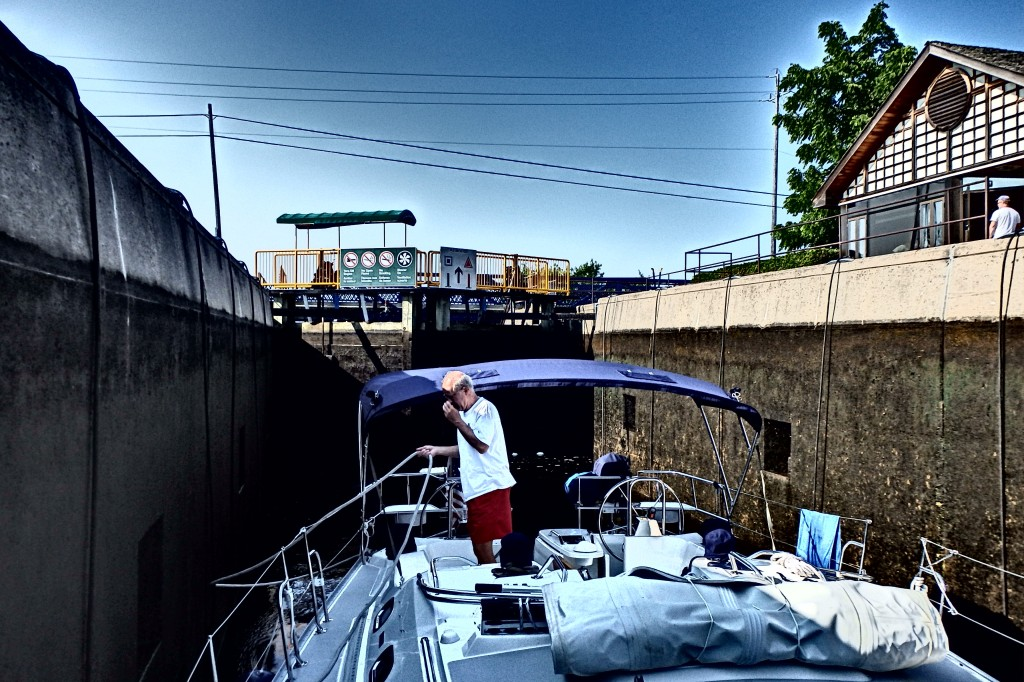 At the bottom of the lock.